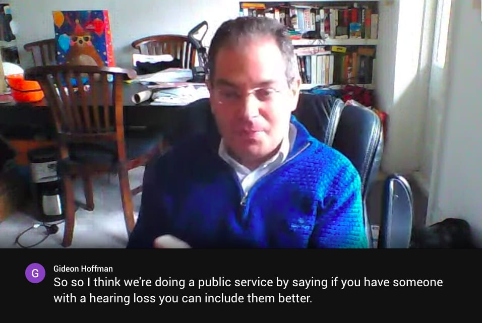 Screenshot of Google Hangouts Meet video call in process. The key speaker's words are transcribed live beneath the video window.